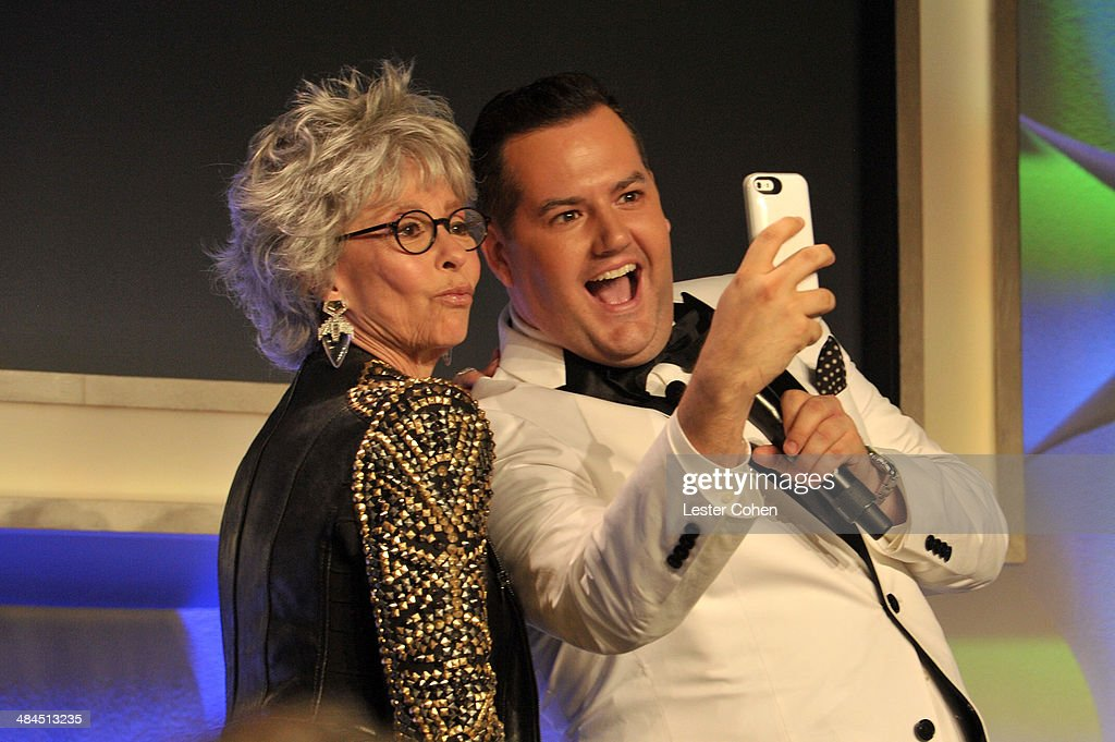 Actress Rita Moreno (L) TV Personality Ross Mathews taking selfie onstage at the 25th Annual GLAAD Media Awards at The Beverly Hilton Hotel on April 12, 2014 in Los Angeles, California.