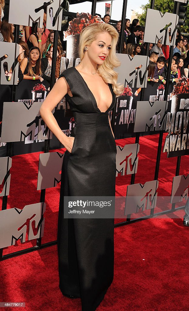 Actress <a gi-track='captionPersonalityLinkClicked' href=/galleries/search?phrase=Rita+Ora&family=editorial&specificpeople=5686485 ng-click='$event.stopPropagation()'>Rita Ora</a> attends the 2014 MTV Movie Awards at Nokia Theatre L.A. Live on April 13, 2014 in Los Angeles, California.