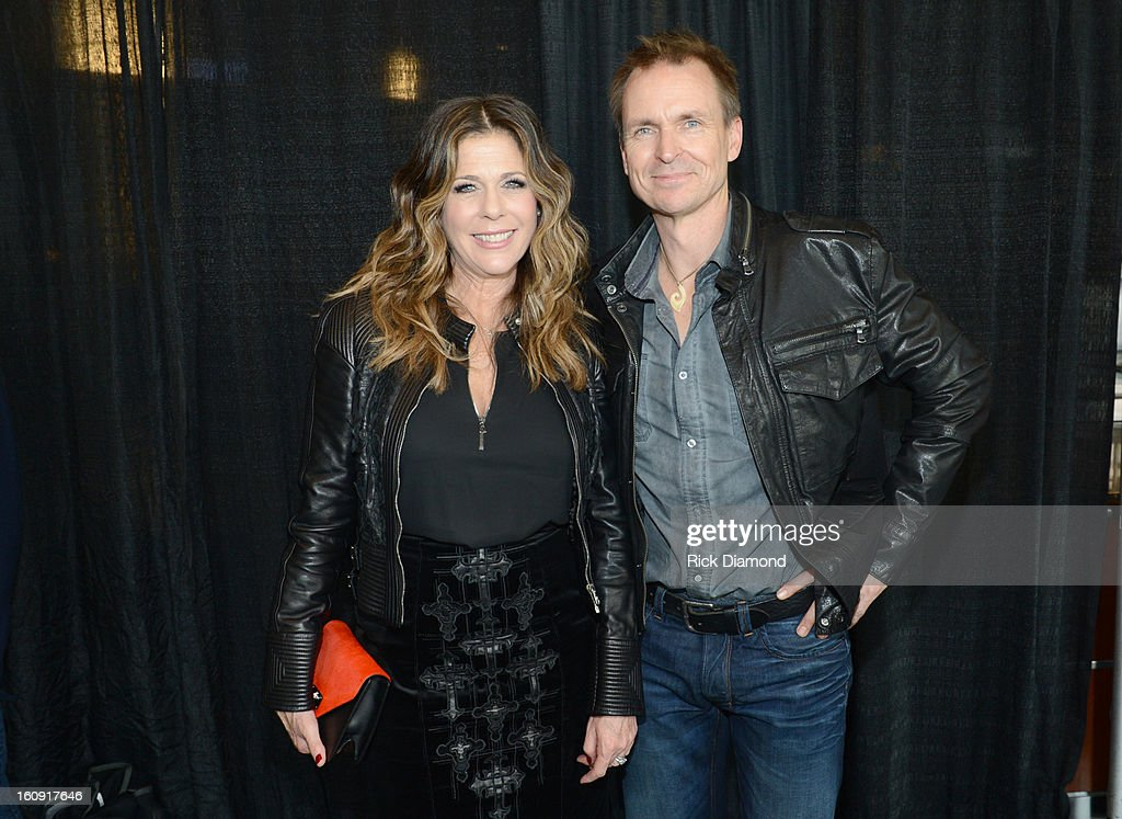 Actress Rita Wilson (L) and TV personality Phil Keoghan pose backstage at the GRAMMYs Dial Global Radio Remotes during The 55th Annual GRAMMY Awards at the STAPLES Center on February 7, 2013 in Los Angeles, California.