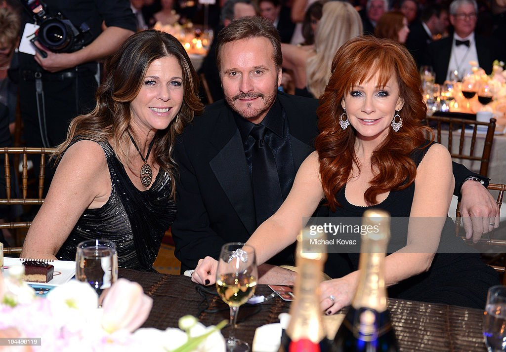 Actress Rita Wilson, Narvel Blackstock, and singer Reba McEntire with Moet & Chandon at Celebrity Fight Night XIX at JW Marriott Desert Ridge Resort & Spa on March 23, 2013 in Phoenix, Arizona.