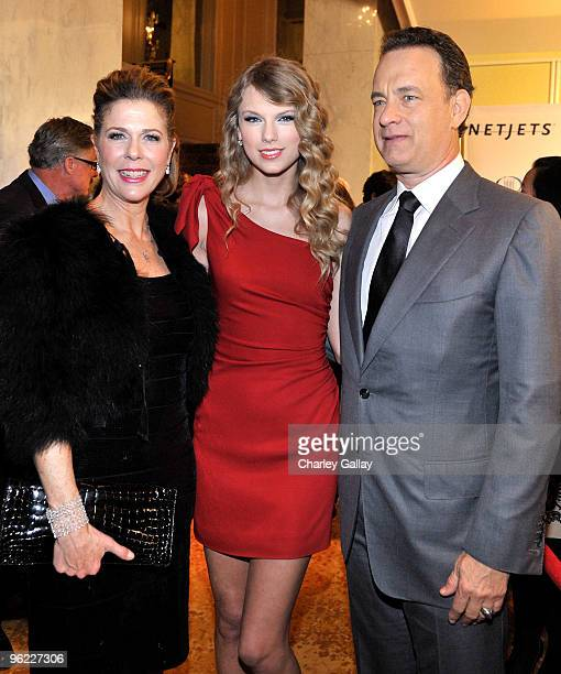 Actress Rita Wilson singer Taylor Swift and actor Tom Hanks attend the Neuro hosted cocktail hour and juniors room at the EIF's Women's Cancer at The...