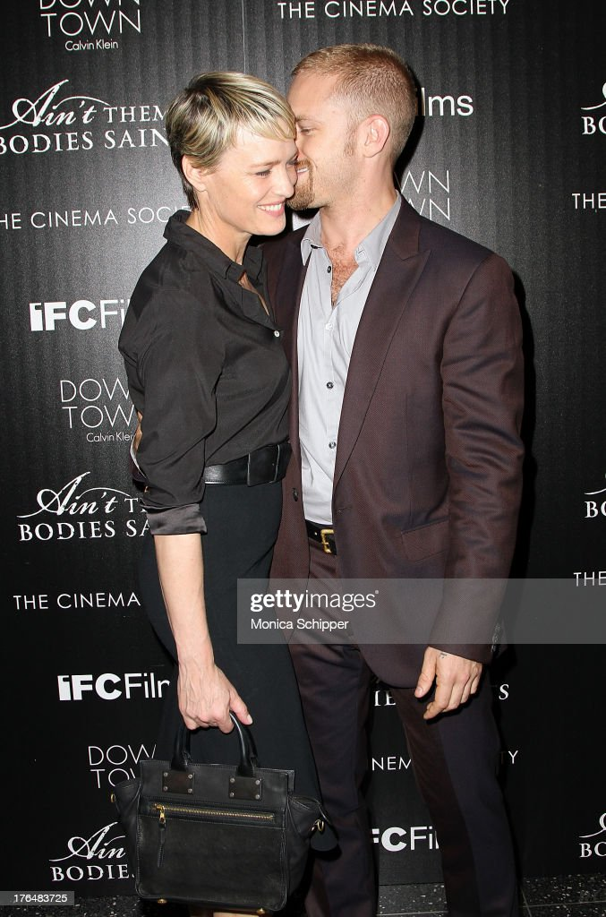 Actress <a gi-track='captionPersonalityLinkClicked' href=/galleries/search?phrase=Robin+Wright&family=editorial&specificpeople=207147 ng-click='$event.stopPropagation()'>Robin Wright</a> and actor Ben Foster attend the Downtown Calvin Klein with The Cinema Society screening of IFC Films' 'Ain't Them Bodies Saints' at The Museum of Modern Art on August 13, 2013 in New York City.