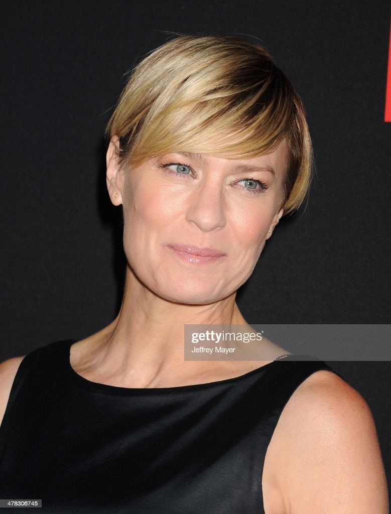 Actress <a gi-track='captionPersonalityLinkClicked' href=/galleries/search?phrase=Robin+Wright&family=editorial&specificpeople=207147 ng-click='$event.stopPropagation()'>Robin Wright</a> arrives at the 'House Of Cards' Season 2 special screening at Directors Guild Of America on February 13, 2014 in Los Angeles, California.