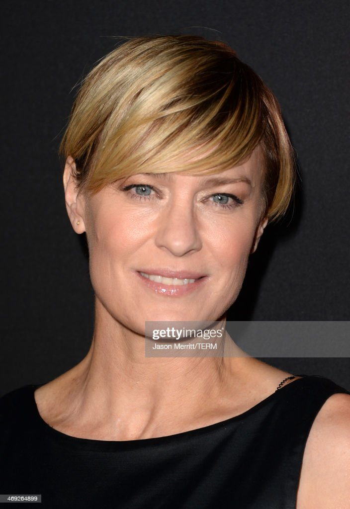 Actress <a gi-track='captionPersonalityLinkClicked' href=/galleries/search?phrase=Robin+Wright&family=editorial&specificpeople=207147 ng-click='$event.stopPropagation()'>Robin Wright</a> arrives at the special screening of Netflix's 'House of Cards' Season 2 at the Directors Guild of America on February 13, 2014 in Los Angeles, California.