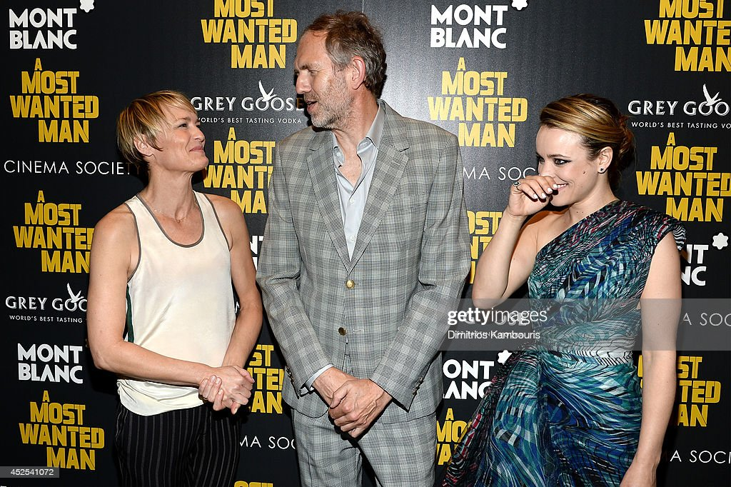 Actress <a gi-track='captionPersonalityLinkClicked' href=/galleries/search?phrase=Robin+Wright&family=editorial&specificpeople=207147 ng-click='$event.stopPropagation()'>Robin Wright</a>, director <a gi-track='captionPersonalityLinkClicked' href=/galleries/search?phrase=Anton+Corbijn&family=editorial&specificpeople=2211821 ng-click='$event.stopPropagation()'>Anton Corbijn</a> and actress <a gi-track='captionPersonalityLinkClicked' href=/galleries/search?phrase=Rachel+McAdams&family=editorial&specificpeople=212942 ng-click='$event.stopPropagation()'>Rachel McAdams</a> attend Lionsgate and Roadside Attraction's premiere of 'A Most Wanted Man' hosted by The Cinema Society and Montblanc at the Museum of Modern Art on July 22, 2014 in New York City.