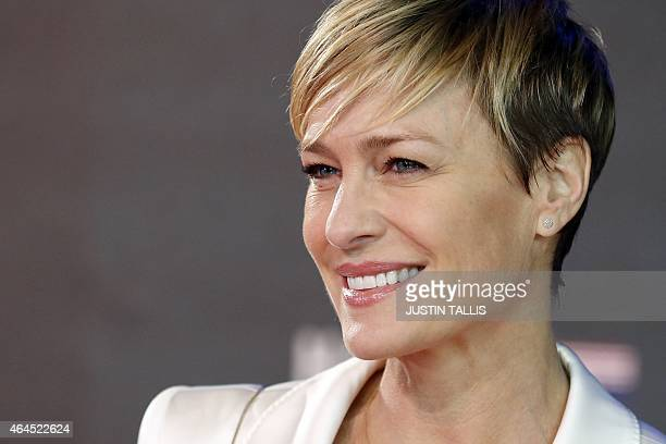 US actress Robin Wright poses for photographers on the red carpet ahead of the world premiere of the television series 'House of Cards Season 3...
