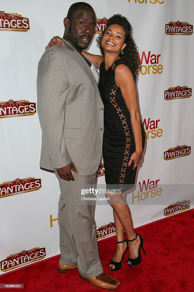 Actress <a gi-track='captionPersonalityLinkClicked' href=/galleries/search?phrase=Rochelle+Aytes&family=editorial&specificpeople=843599 ng-click='$event.stopPropagation()'>Rochelle Aytes</a> (R) attends the 'War Horse' red carpet opening night at the Pantages Theatre on October 8, 2013 in Hollywood, California.
