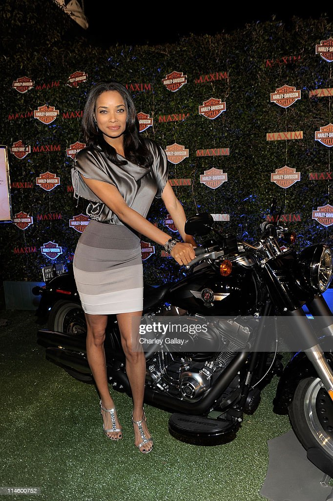 Actress Rochelle Aytes turns the key on a HarleyDavidson to raise money for Harley's Heroes at the 2010 Maxim Hot 100 Party held at Paramount Studios...
