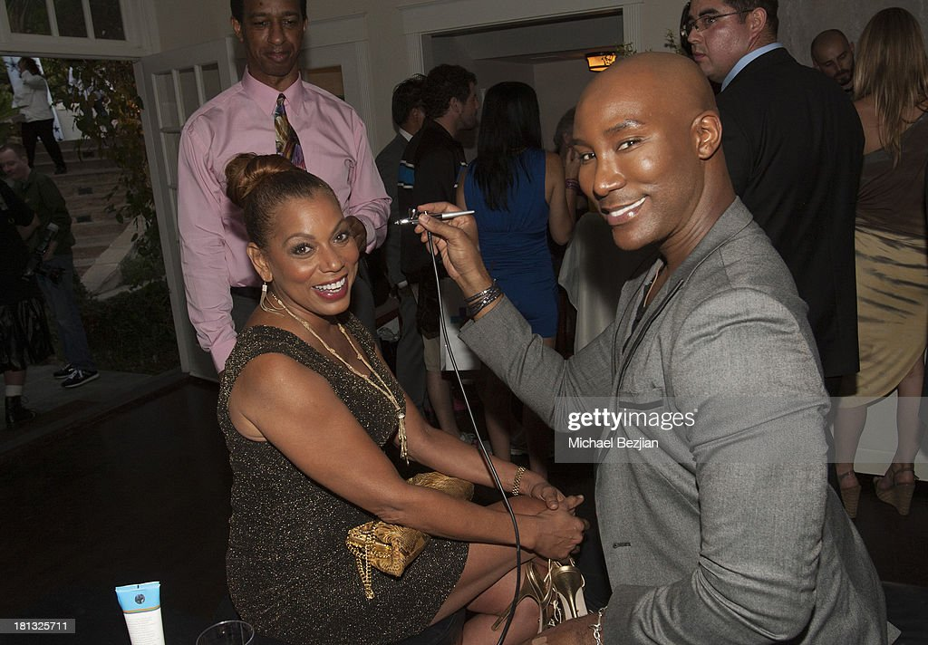 Actress Rolanda Watts gets airbrushed by Marc Harvey of 'Element 2 Beauty' at Mark Kearney Group - 'Iced Out' Luxury Emmy Suite on September 19, 2013 in Los Angeles, California.