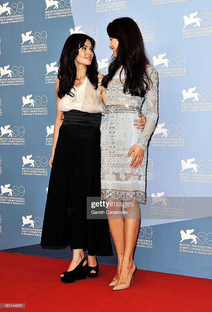 Actress Romina Mondello (L) and actress <a gi-track='captionPersonalityLinkClicked' href=/galleries/search?phrase=Olga+Kurylenko&family=editorial&specificpeople=630281 ng-click='$event.stopPropagation()'>Olga Kurylenko</a> attend the 'To The Wonder' Photocall during the 69th Venice Film Festival at the Palazzo del Casino on September 2, 2012 in Venice, Italy.