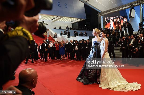 US actress Rooney Mara and Australian actress Cate Blanchett pose before leaving the Festival palace after the screening of the film 'Carol' at the...