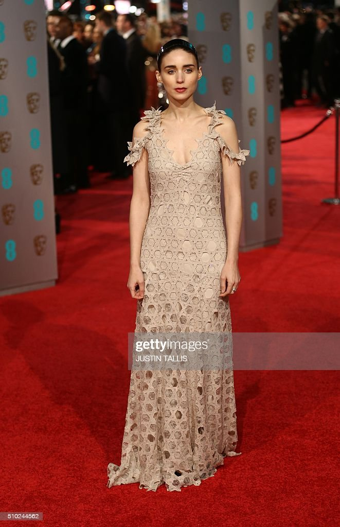 US actress Rooney Mara poses on arrival for the BAFTA British Academy Film Awards at the Royal Opera House in London on February 14, 2016. TALLIS