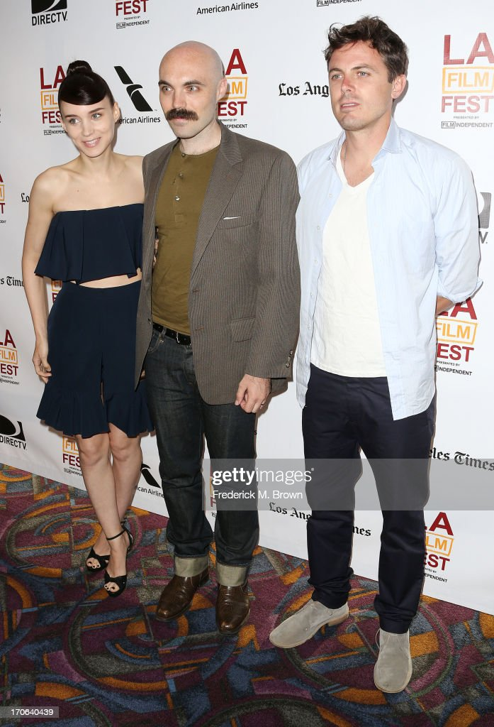 Actress <a gi-track='captionPersonalityLinkClicked' href=/galleries/search?phrase=Rooney+Mara&family=editorial&specificpeople=5669181 ng-click='$event.stopPropagation()'>Rooney Mara</a>, writer director David Lowery and actor <a gi-track='captionPersonalityLinkClicked' href=/galleries/search?phrase=Casey+Affleck&family=editorial&specificpeople=1539212 ng-click='$event.stopPropagation()'>Casey Affleck</a> attend the 2013 Los Angeles Film Festival screening of IFC Films' 'Ain't Them Bodies Saints' at the Regal Cinemas L.A. Live on June 15, 2013 in Los Angeles, California.