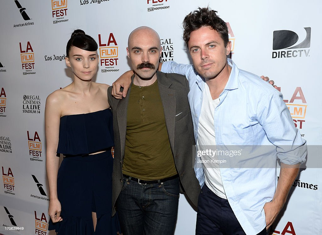 Actress <a gi-track='captionPersonalityLinkClicked' href=/galleries/search?phrase=Rooney+Mara&family=editorial&specificpeople=5669181 ng-click='$event.stopPropagation()'>Rooney Mara</a>, writer/director David Lowery and actor <a gi-track='captionPersonalityLinkClicked' href=/galleries/search?phrase=Casey+Affleck&family=editorial&specificpeople=1539212 ng-click='$event.stopPropagation()'>Casey Affleck</a> arrive at the 'Ain't Them Bodies Saints' premiere during the 2013 Los Angeles Film Festival at Regal Cinemas L.A. Live on June 15, 2013 in Los Angeles, California.