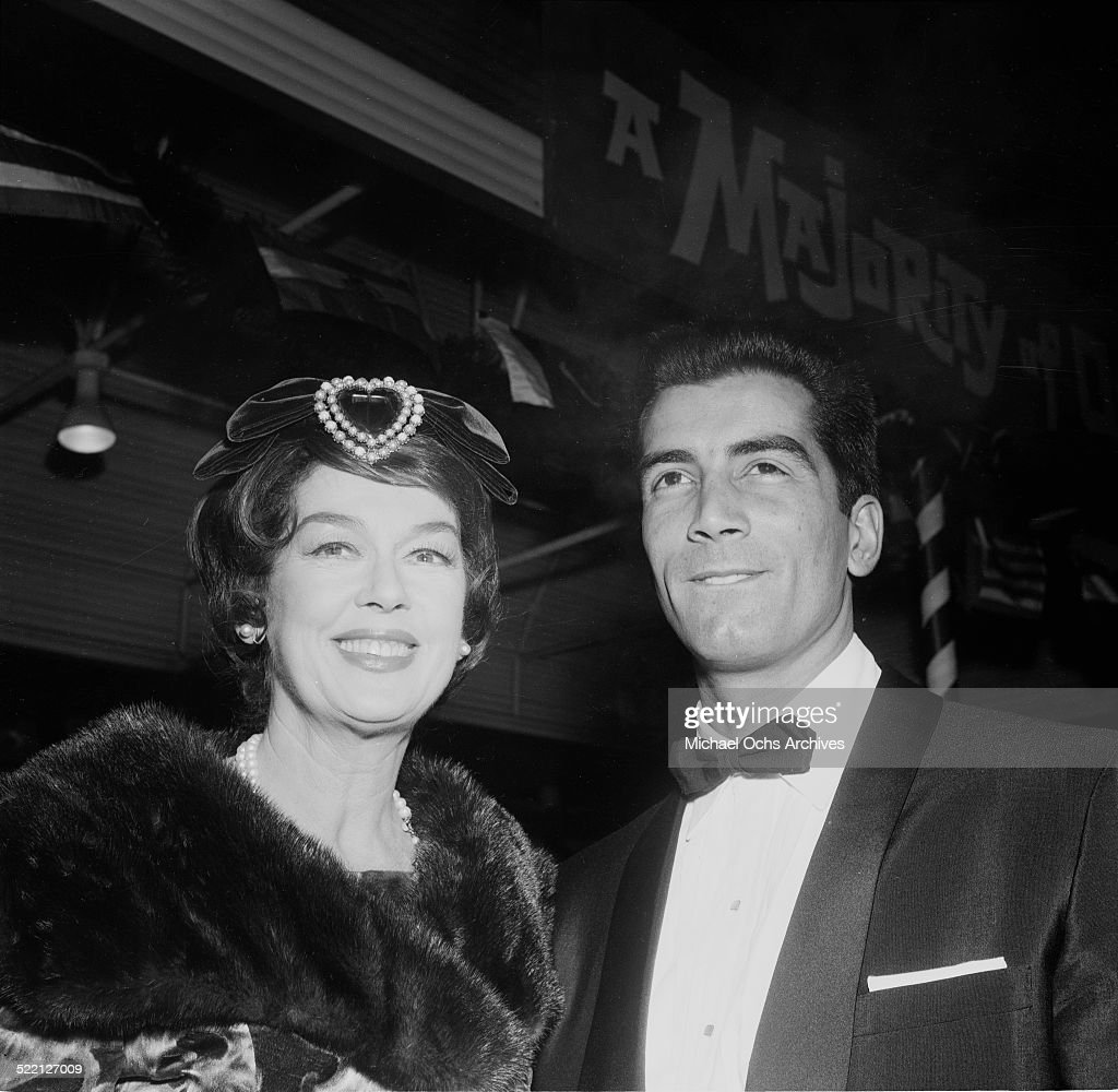 Actress <a gi-track='captionPersonalityLinkClicked' href=/galleries/search?phrase=Rosalind+Russell&family=editorial&specificpeople=206523 ng-click='$event.stopPropagation()'>Rosalind Russell</a> and actor Ray Danton attend an event in Los Angeles,CA.