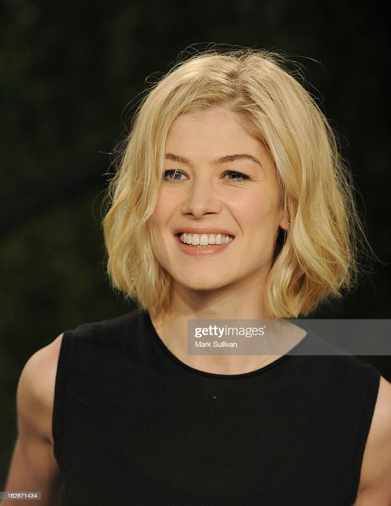 Actress Rosamund Pike arrives at the 2013 Vanity Fair Oscar Party at Sunset Tower on February 24, 2013 in West Hollywood, California.