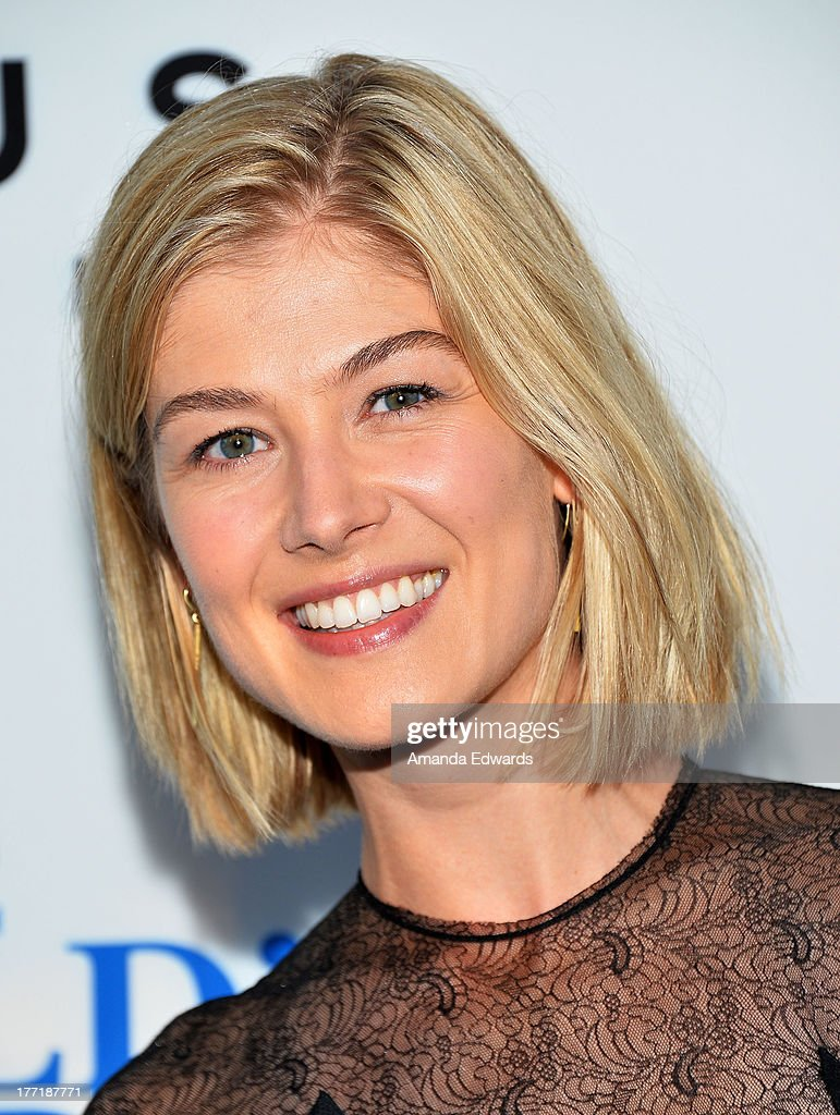 Actress <a gi-track='captionPersonalityLinkClicked' href=/galleries/search?phrase=Rosamund+Pike&family=editorial&specificpeople=208910 ng-click='$event.stopPropagation()'>Rosamund Pike</a> arrives at the Los Angeles premiere of 'The World's End' at ArcLight Cinemas Cinerama Dome on August 21, 2013 in Hollywood, California.