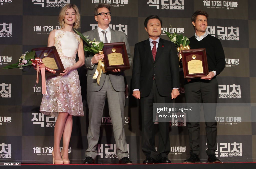 Actress Rosamund Pike, director Christopher McQuarrie and actor Tom Cruise receive an honorary citizens of the Busan City from City mayor Huh Nam-Shik (2R) during the 'Jack Reacher' Fan Screening at Busan Cinema Center on January 10, 2013 in Busan, South Korea. The film will open on January 17 in Korea.
