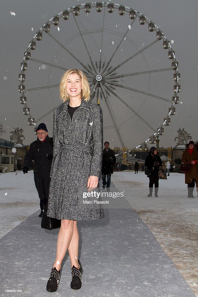 Actress <a gi-track='captionPersonalityLinkClicked' href=/galleries/search?phrase=Rosamund+Pike&family=editorial&specificpeople=208910 ng-click='$event.stopPropagation()'>Rosamund Pike</a> is seen leaving the Christian Dior Spring/Summer 2013 Haute-Couture show as part of Paris Fashion Week at on January 21, 2013 in Paris, France.