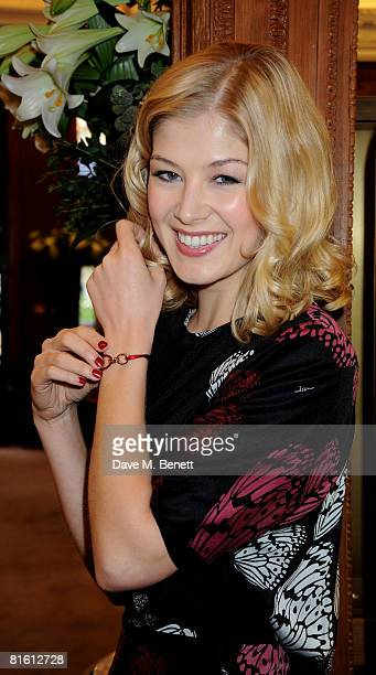 Actress Rosamund Pike poses to launch the the Cartier Love Charity Bracelet in support of Action Against Hunger at Cartier New Bond Street on June 18...