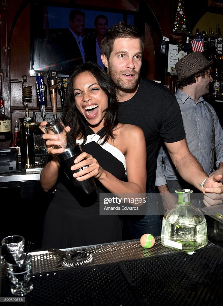 Actress Rosario Dawson (L) and actor Geoff Stults work behind the bar at Geoff Stults' birthday party fundraiser to benefit The Charlotte and Gwenyth Gray Foundation at Rock and Reilly's Irish Pub on December 9, 2015 in West Hollywood, California.