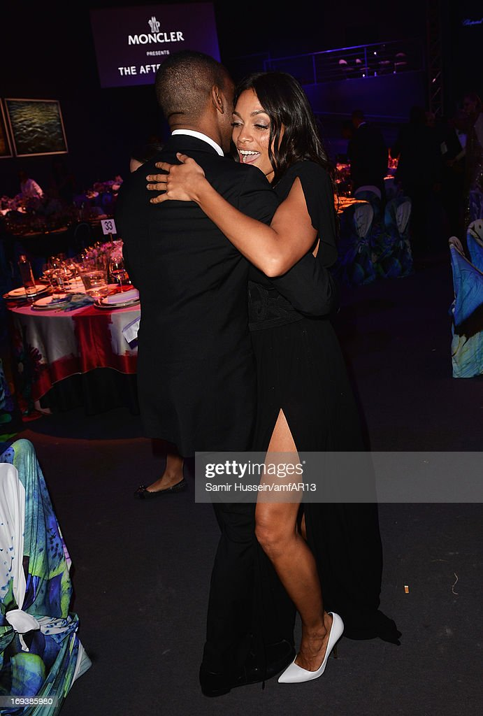 Actress <a gi-track='captionPersonalityLinkClicked' href=/galleries/search?phrase=Rosario+Dawson&family=editorial&specificpeople=201472 ng-click='$event.stopPropagation()'>Rosario Dawson</a> and guest attend amfAR's 20th Annual Cinema Against AIDS during The 66th Annual Cannes Film Festival at Hotel du Cap-Eden-Roc on May 23, 2013 in Cap d'Antibes, France.