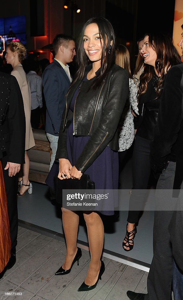 Actress <a gi-track='captionPersonalityLinkClicked' href=/galleries/search?phrase=Rosario+Dawson&family=editorial&specificpeople=201472 ng-click='$event.stopPropagation()'>Rosario Dawson</a> carrying Coach, attends Coach's 3rd Annual Evening of Cocktails and Shopping to Benefit the Children's Defense Fund hosted by Katie McGrath, J.J. Abrams and Bryan Burk at Bad Robot on April 10, 2013 in Santa Monica, California.