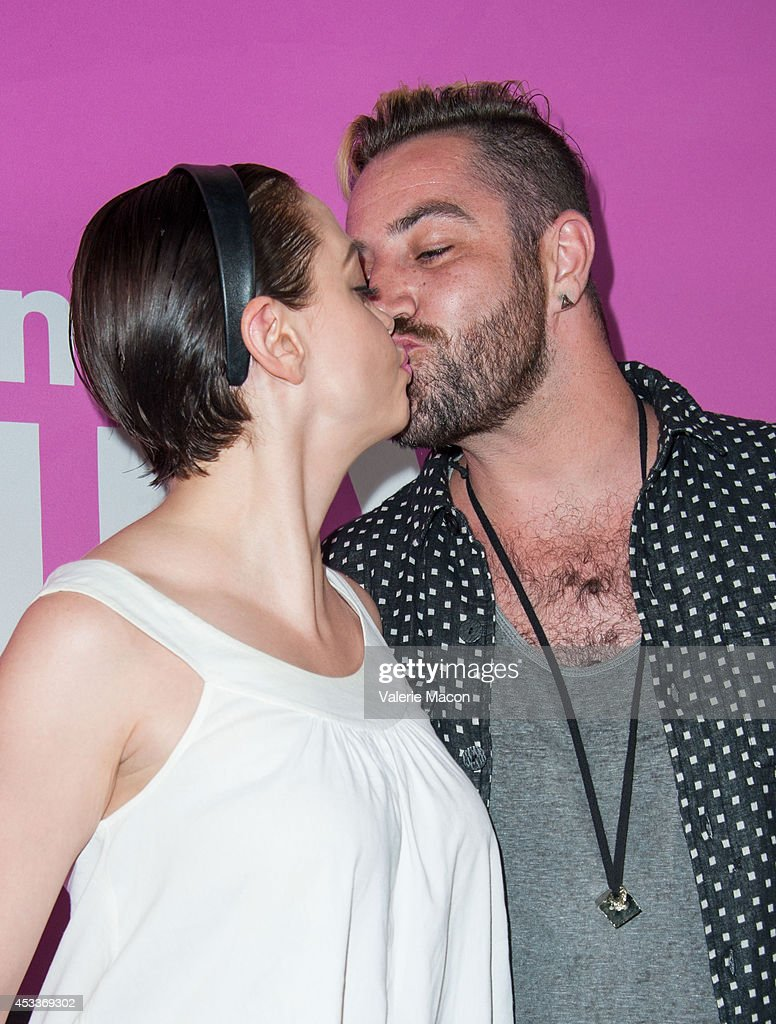 Actress Rose McGowan (L) and Davey Detail arrive at Sundance NextFest Film Festival Premiere Of 'Life After Beth' at The Theatre At The Ace Hotel on August 8, 2014 in Los Angeles, California.