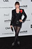 Actress Rose McGowan arrives at amfAR's Inspiration Gala at Milk Studios on October 11 2012 in Hollywood California