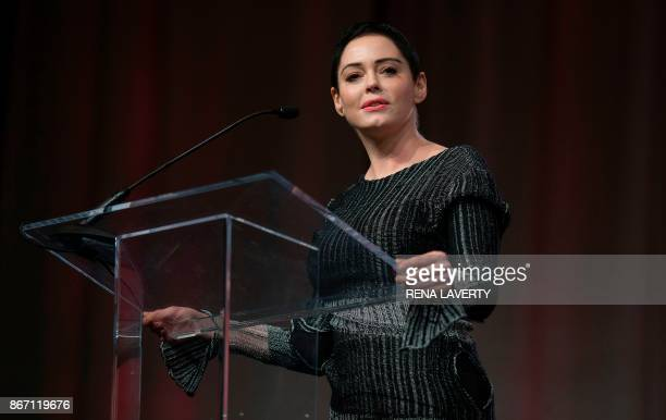US actress Rose McGowan gives opening remarks to the audience at the Women's March / Women's Convention in Detroit Michigan on October 27 2017 A...