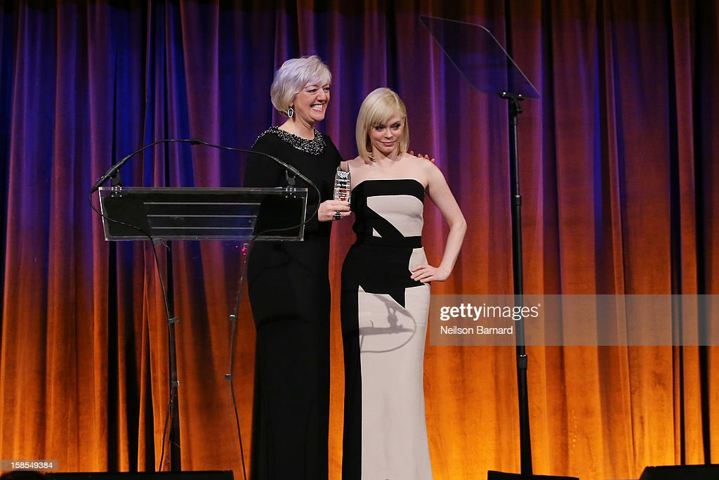 Actress Rose McGowan (R) presents honoree Cathy Kangas an award on stage during The Humane Society of the United States' To the Rescue! New York Gala at Cipriani 42nd Street on December 18, 2012 in New York City.