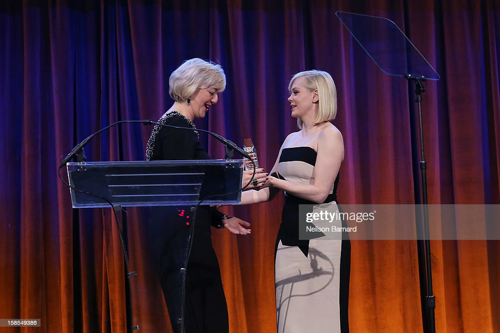 Actress <a gi-track='captionPersonalityLinkClicked' href=/galleries/search?phrase=Rose+McGowan&family=editorial&specificpeople=206451 ng-click='$event.stopPropagation()'>Rose McGowan</a> (R) presents honoree Cathy Kangas an award on stage during The Humane Society of the United States' To the Rescue! New York Gala at Cipriani 42nd Street on December 18, 2012 in New York City.