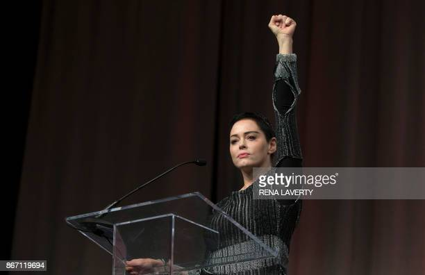 US actress Rose McGowan raises her fist during her opening remarks to the audience at the Women's March / Women's Convention in Detroit Michigan on...