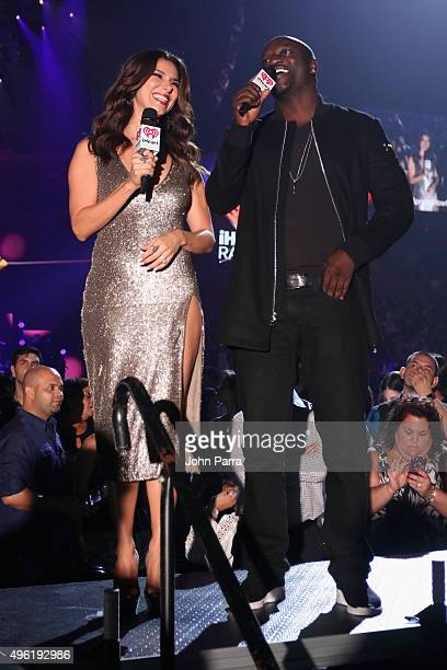 Actress Roselyn Sanchez and recording artist Akon speak on stage at iHeartRadio Fiesta Latina presented by Sprint at American Airlines Arena on...