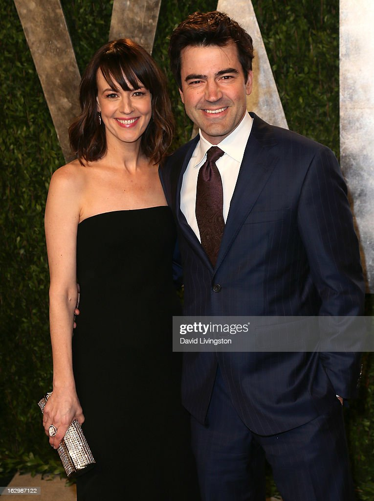 Actress Rosemarie DeWitt (L) and husband actor Ron Livingston attend the 2013 Vanity Fair Oscar Party at the Sunset Tower Hotel on February 24, 2013 in West Hollywood, California.