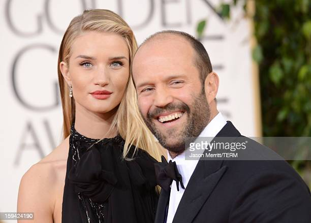 Actress Rosie HuntingtonWhiteley and actor Jason Statham arrive at the 70th Annual Golden Globe Awards held at The Beverly Hilton Hotel on January 13...