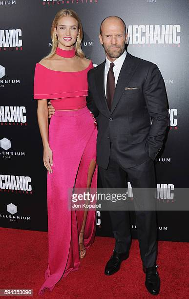 Actress Rosie HuntingtonWhiteley and actor Jason Statham arrive at the Los Angeles Premiere 'Mechanic Resurrection' at ArcLight Hollywood on August...