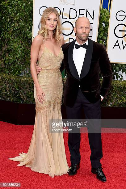Actress Rosie HuntingtonWhiteley and actor Jason Statham attend the 73rd Annual Golden Globe Awards held at the Beverly Hilton Hotel on January 10...
