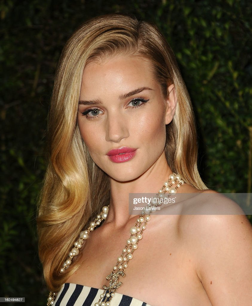 Actress Rosie Huntington-Whiteley attends the Chanel Pre-Oscar dinner at Madeo Restaurant on February 23, 2013 in Los Angeles, California.