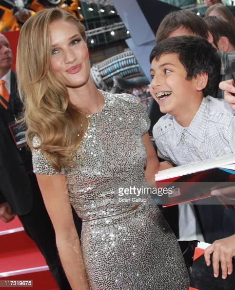 Actress Rosie HuntingtonWhiteley gets an admiring glance from a fan as she attends the 'Transformers 3' European premiere on June 25 2011 in Berlin...