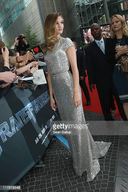 Actress Rosie HuntingtonWhiteley signs autographs as she attends the 'Transformers 3' European premiere on June 25 2011 in Berlin Germany