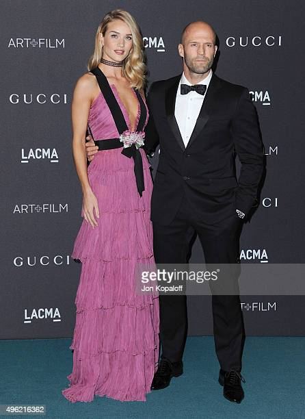 Actress Rosie HuntingtonWhiteley wearing Gucci and actor Jason Statham attend the LACMA Art Film Gala honoring Alejandro Gonzalez Iarritu and James...