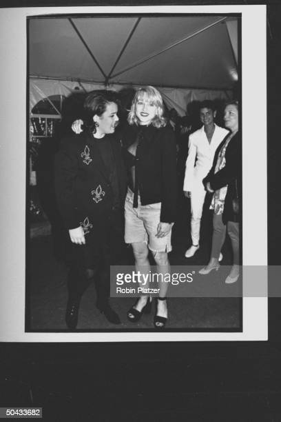 Actress Rosie O'Donnell arminarm w singer/actress Madonna as they chat affectionately at premiere party for the movie A League of Their Own at Tavern...