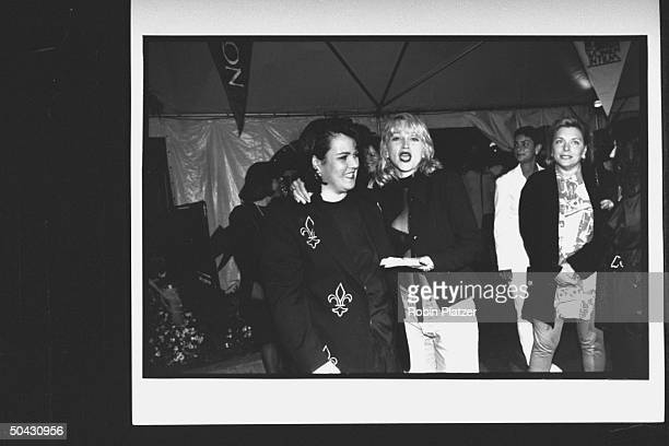 Actress Rosie O'Donnell chatting w singer/actress Madonna at premiere party for the movie A League of Their Own at Tavern on the Green restaurant