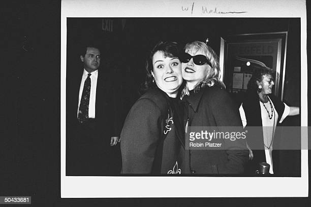 Actress Rosie O'Donnell posing cheektocheek w singer/actress Madonna amongst others at premiere party for the movie A League of Their Own at Tavern...