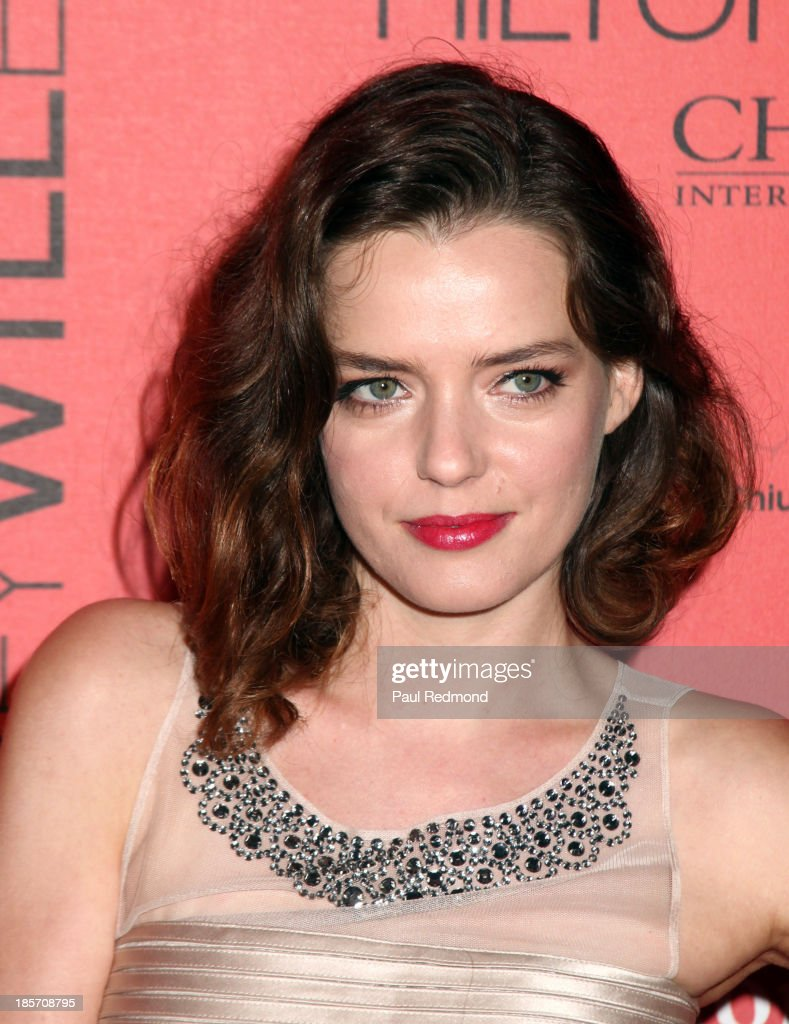Actress <a gi-track='captionPersonalityLinkClicked' href=/galleries/search?phrase=Roxane+Mesquida&family=editorial&specificpeople=217749 ng-click='$event.stopPropagation()'>Roxane Mesquida</a> arrives at FGILA's 5th Annual Designer & The Muse hosted by Kathy Hilton at Mr. C Beverly Hills on October 23, 2013 in Beverly Hills, California.