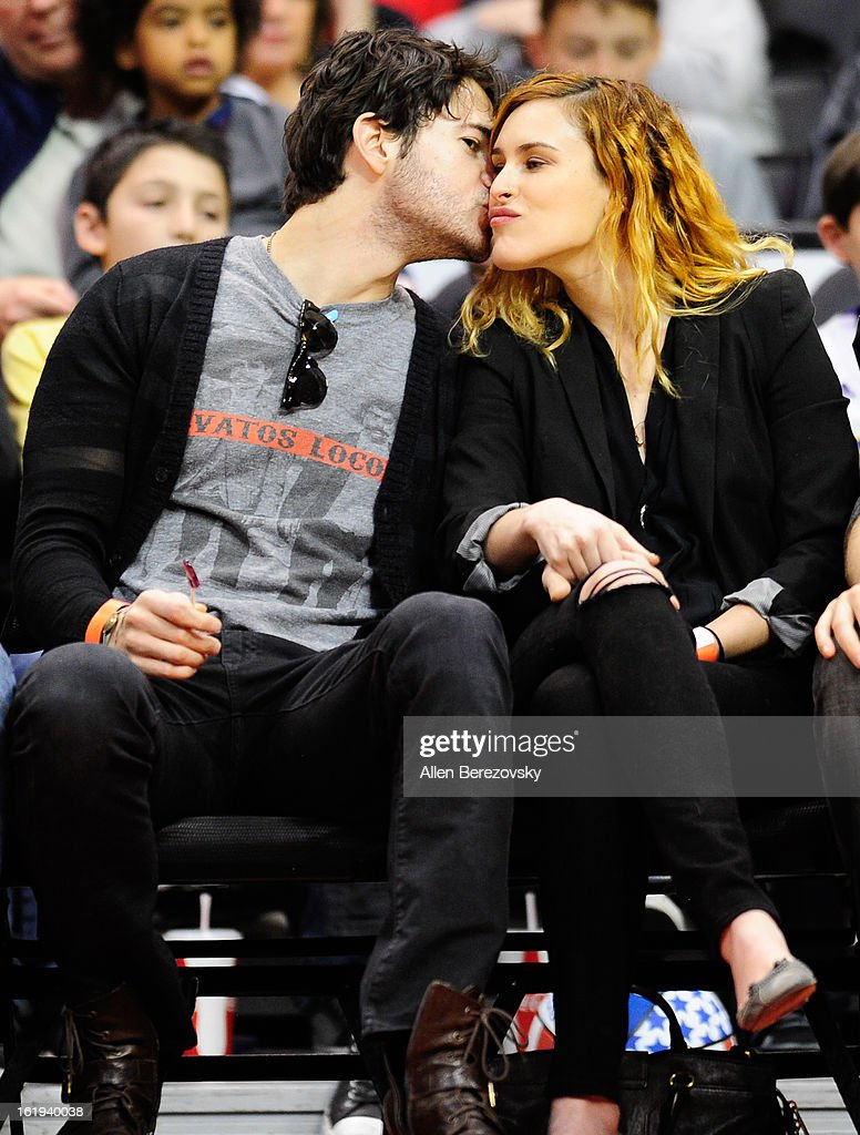 Actress <a gi-track='captionPersonalityLinkClicked' href=/galleries/search?phrase=Rumer+Willis&family=editorial&specificpeople=617003 ng-click='$event.stopPropagation()'>Rumer Willis</a> (R) and actor Jayson Blair attend the Harlem Globetrotters 'You Write The Rules' 2013 tour game at Staples Center on February 17, 2013 in Los Angeles, California.