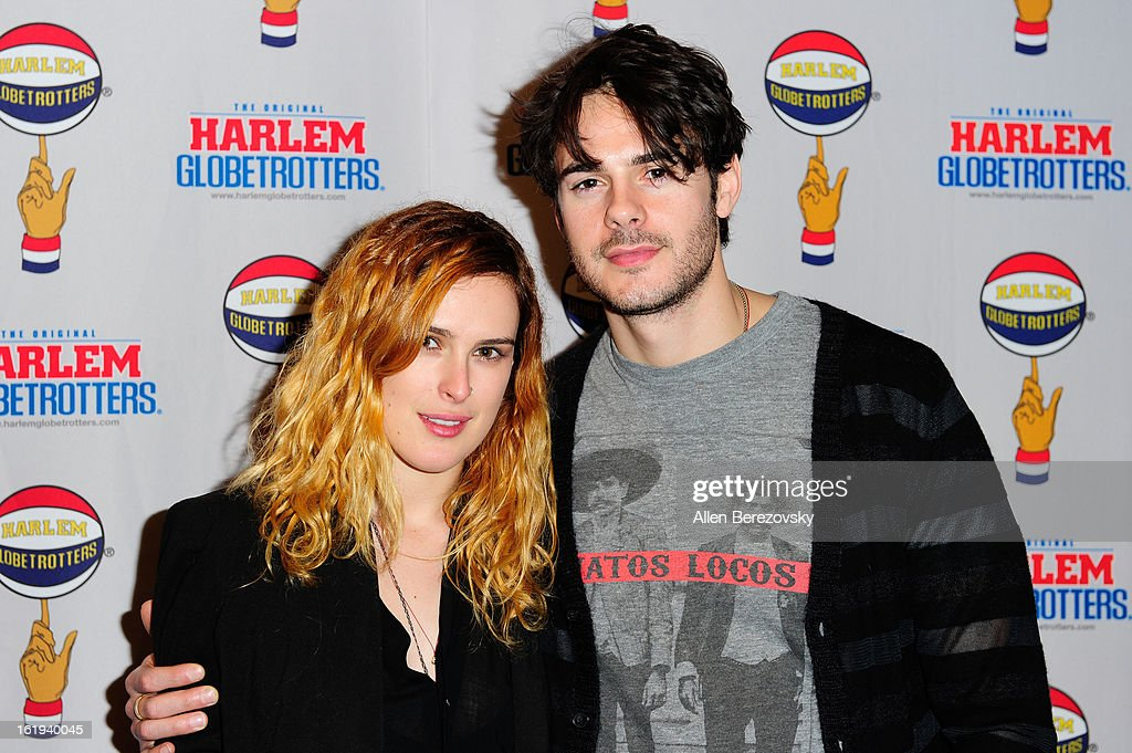 Actress Rumer Willis and actor Jayson Blair attend the Harlem Globetrotters 'You Write The Rules' 2013 tour game at Staples Center on February 17, 2013 in Los Angeles, California.
