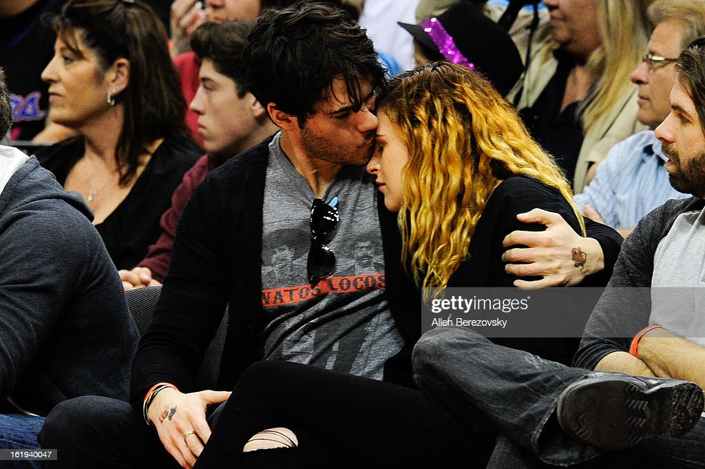 Actress Rumer Willis (R) and actor Jayson Blair attend the Harlem Globetrotters 'You Write The Rules' 2013 tour game at Staples Center on February 17, 2013 in Los Angeles, California.