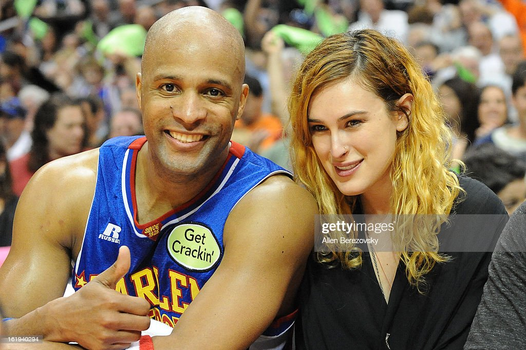 Actress Rumer Willis (R) and Flighttime Lang of Harlem Globetrotters attend the Harlem Globetrotters 'You Write The Rules' 2013 tour game at Staples Center on February 17, 2013 in Los Angeles, California.